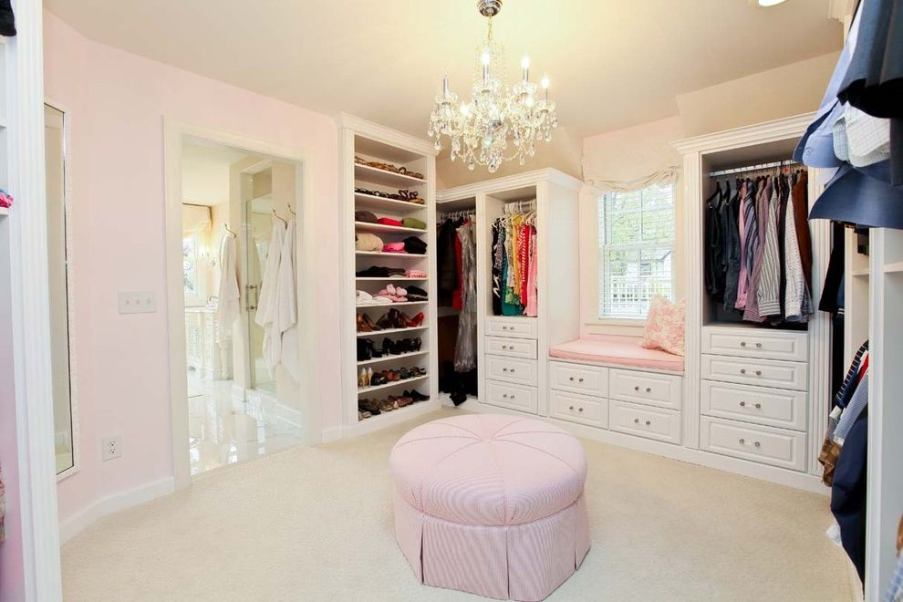 California Closets Cost with Traditional Closet Also Built in Shelves California Closets Chandelier Closet Double Hung Racks Hanging Clothes Racks Pink Walls Pouf Shoe Storage Walk in Closet Window Seat