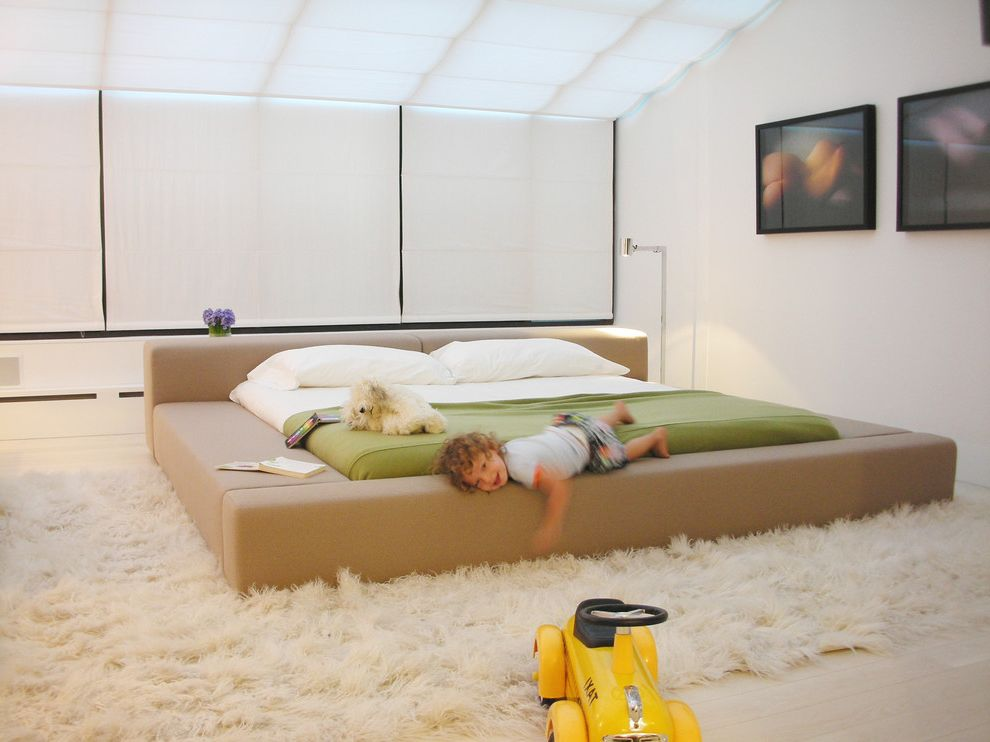 Car Rugs for Toddlers   Scandinavian Bedroom Also Bedroom Storage Built in Cabinets Built in Storage Floor Lamp Low Bed Modern Art Modern Bed Natural Light Roadster Shag Rug Tan Bed Townhouse White Rug Yellow Car