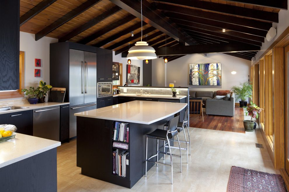 Carbonized Bamboo Flooring with Rustic Kitchen  and Black Cabinets Counter Stools Kitchen Island Tongue and Groove Ceiling Vaulted Ceiling White Counters Wood Floor