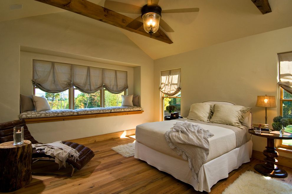 Ceiling Fan with Up and Down Light   Rustic Bedroom  and Beams Bed Blinds Ceiling Fan Chaise Lounge Pedestal Table Rug Traditional Vaulted Ceiling Window Seating Window Treatment Wood Beams Wood Floor