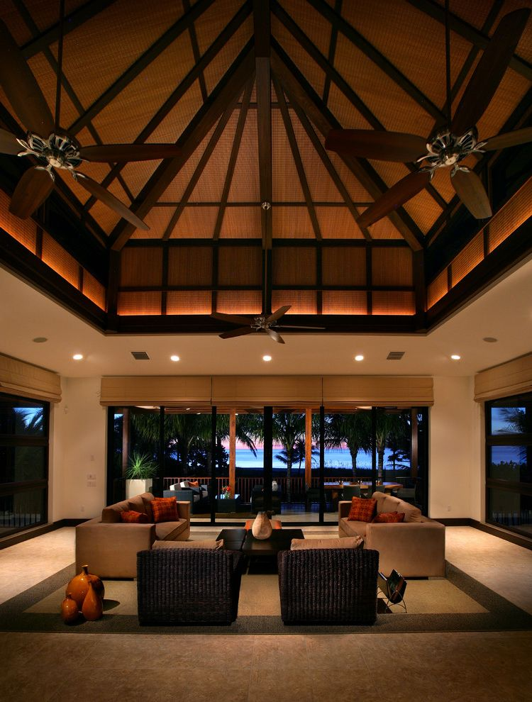 Ceiling Fan with Up and Down Light   Tropical Living Room  and Area Rug Basket Beams Blinds Ceiling Dark Trim Ocean View Symmetry Tropical Vase Water View Wicker Wood Ceiling