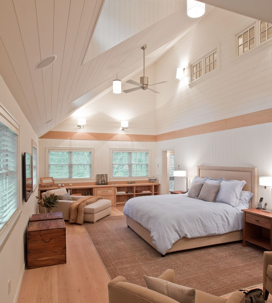 Ceiling Fan with Up and Down Light with Transitional Bedroom  and Armchair Bed Bookcase Bookshelves Ceiling Fan Daybed Shelves Sisal Rug Skylight Vaulted Ceiling Wood Floor