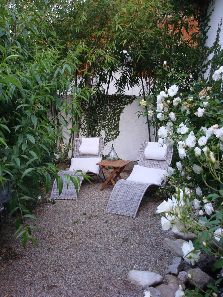 Chapter 11 Furniture   Contemporary Landscape  and Back Yard Bamboo Chaise Lounge Garden Wall Gravel Patio Furniture Privacy Relaxing Roses Secluded White Flowers Wicker Furniture