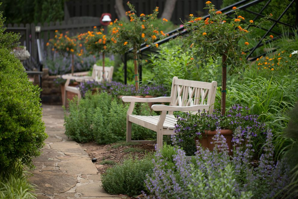 Chapter 11 Furniture with Traditional Landscape  and Flagstone Foliage Garden Bench Orange Flowers Path Patio Furniture Potted Plants Purple Flowers Walkway
