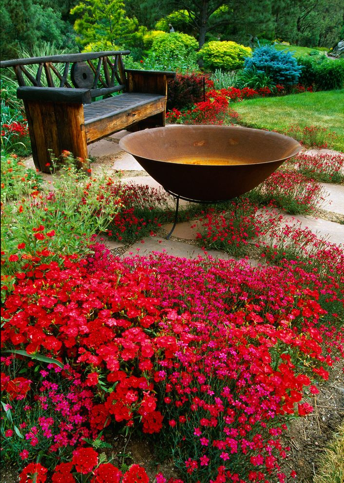City of Flower Mound   Rustic Landscape  and Bench Carnations Dianthus Fire Bowl Flagstone Garden Gravel Mixed Border Patio Red Flowers Rustic