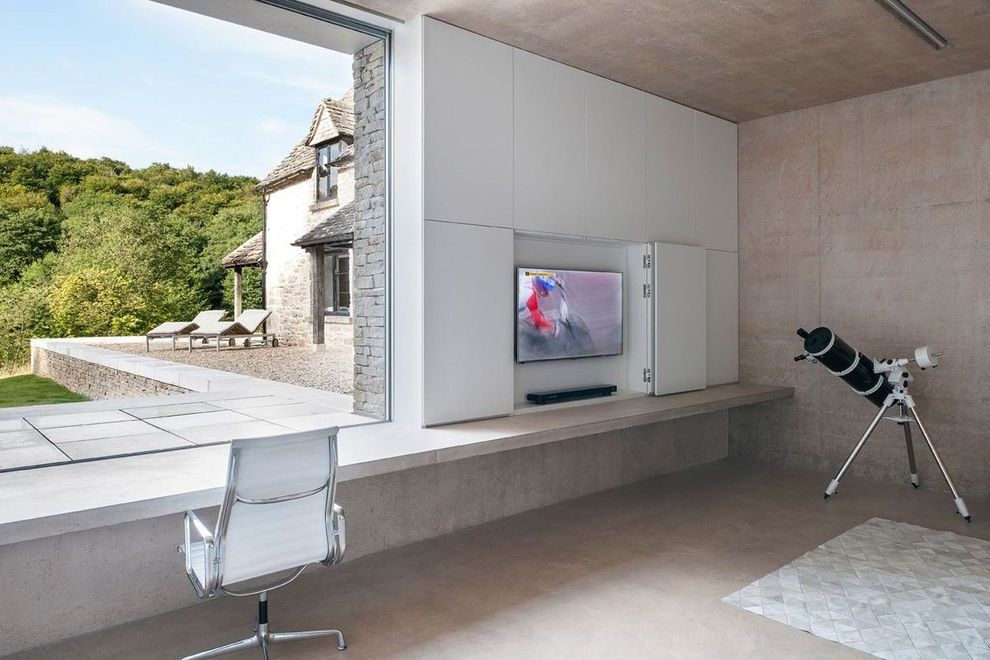 Clean House Tv Show   Modern Home Theater  and Area Rugs Brick Exterior Built in Storage Concrete Eames Chair Indoor Outdoor Indoor Outdoor Living Large Window Modern Natural Stone Tile Office Chairs Telescope Tv