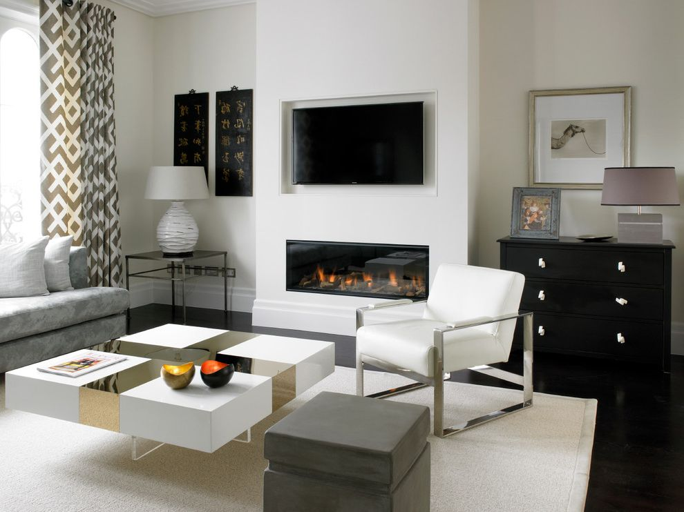 Clean House Tv Show with Contemporary Living Room  and Chrome Furniture Contemporary House Dark Oak Flooring Gas Fireplaces Hole in the Wall Fire Recessed Tv Tv Above Fireplace White and Gold Coffee Table White Armchair White Walls