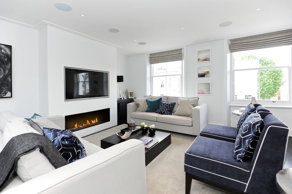Clean House Tv Show with Transitional Living Room  and Beige Carpet Black and White Living Room Patterned Cushions Recessed Lighting Tv Over Fireplace Velvet Chairs Wall Mounted Tv White Walls