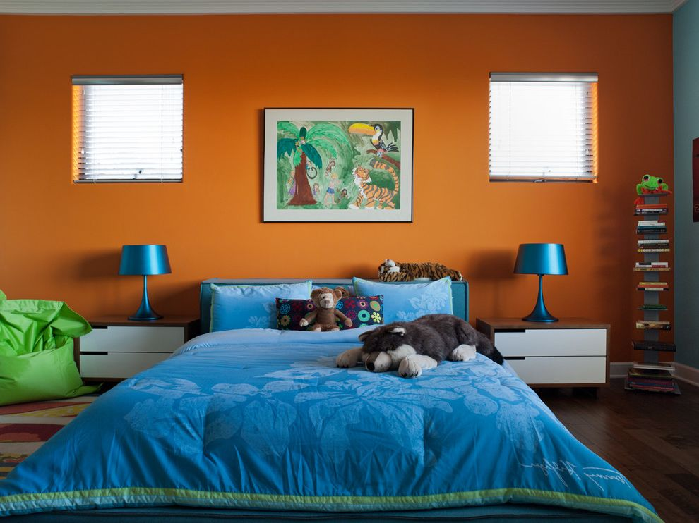 Colors That Go with Orange   Eclectic Kids  and Accent Wall Bean Bag Chair Bed Pillows Bedroom Bedside Table Blue Bedding Bold Colors Dark Floor Nightstand Orange Walls Stuffed Animals Wood Flooring