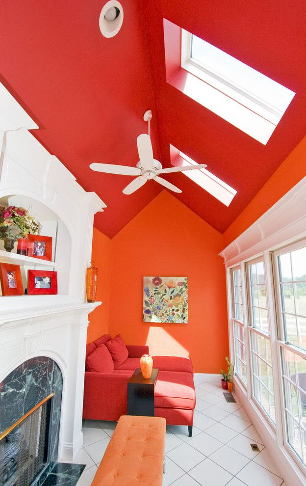Colors That Go with Orange with Traditional Hall  and Ceiling Fan Color Design Fireplace Large Window Mantel Orange Wall Red Ceiling Skylight Style