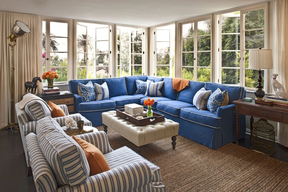 Colors That Go with Orange with Transitional Family Room  and Blue Couch Casement Windows Corner Sofa Curtains Dark Floor Decorative Pillows Drapes Natural Rug Sectional Striped Armchairs Throw Pillows Tufted Ottoman Window Treatments