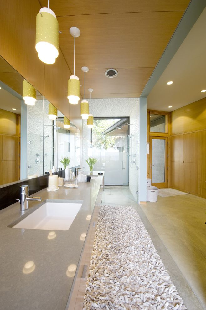 Corian vs Granite   Contemporary Bathroom Also Bath Mat Bathroom Rug Ceiling Lighting Double Sinks Double Vanity Glass Shower Door Pendant Lighting Recessed Lighting Shower Window Wood Ceiling Wood Paneling