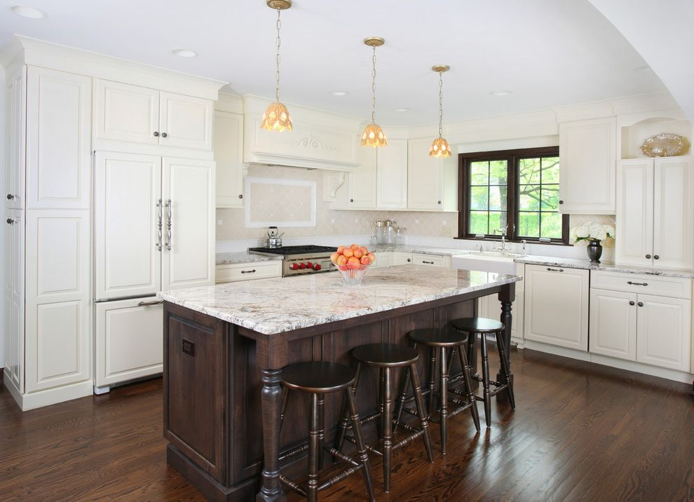 Corian vs Granite with Traditional Kitchen Also Contrast Dark Stained Cabinets Hardwood Floors Island with Seating Stained Island Stained Window Trim Vintage Kitchen White Cabinets White Kitchen
