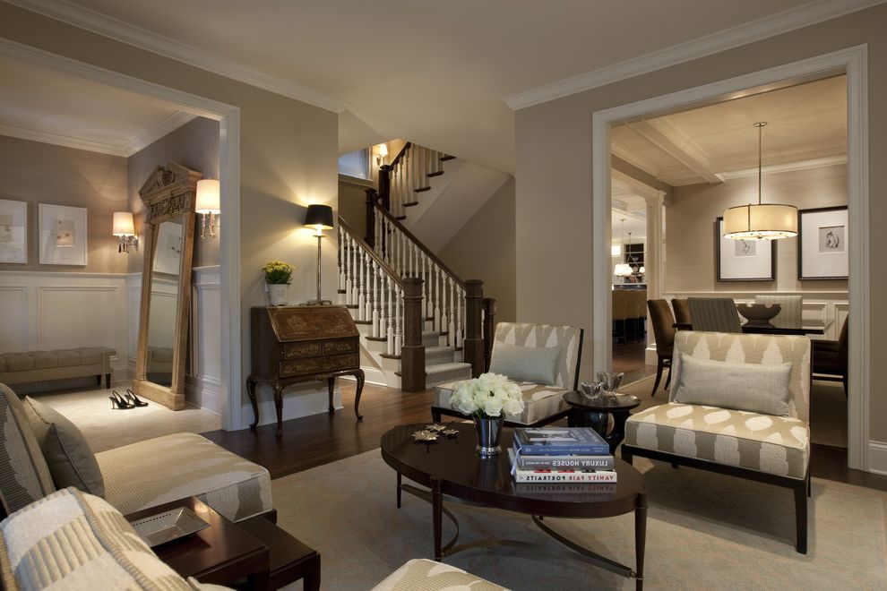 Cost to Paint a Room with Traditional Living Room  and Area Rug Baseboards Dark Floor Drum Pendant Floor Mirror Leaning Mirror Neutral Colors Oval Coffee Table Oversized Mirror Slipper Chairs Wainscoting White Wood Wood Flooring Wood Trim