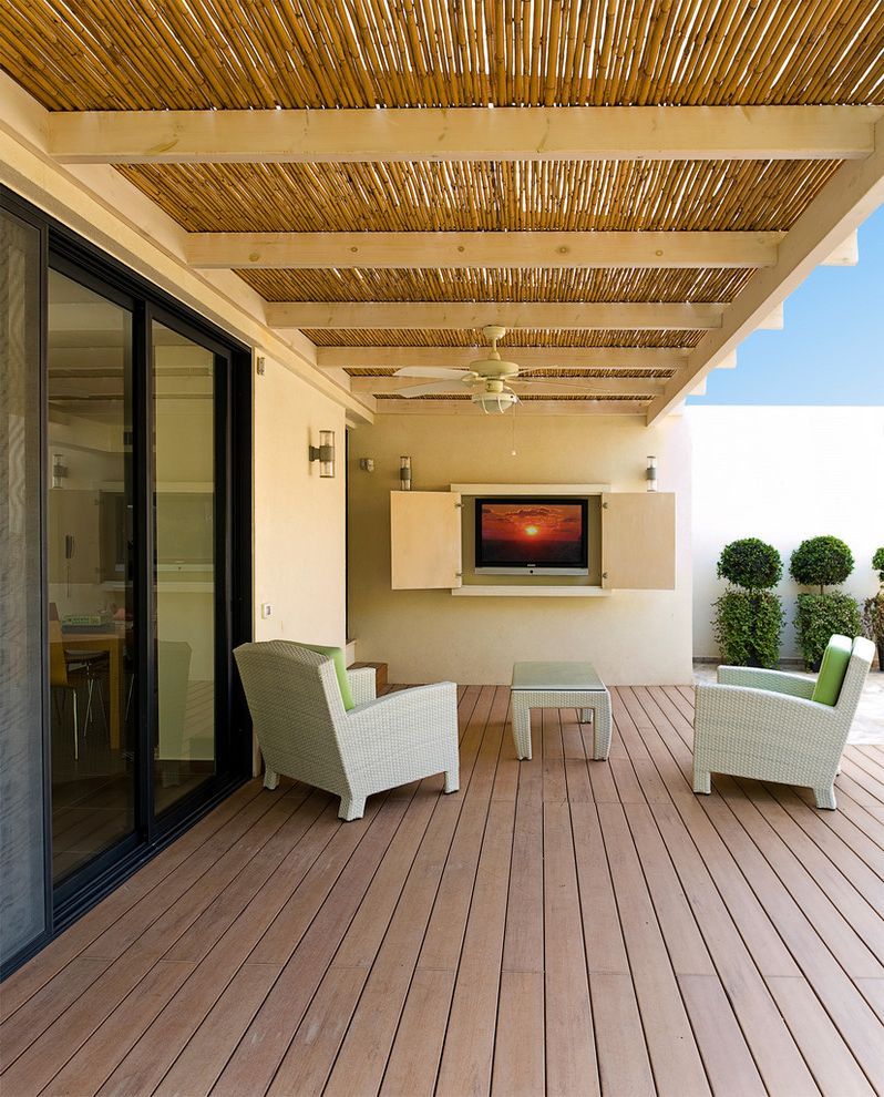 Costco Tv Sales with Contemporary Deck  and Bamboo Ceiling Ceiling Fan Covered Patio Deck Exposed Beams Glass Doors Outdoor Lighting Overhang Patio Furniture Rattan Furniture Sconce Sliding Doors Topiaries Tv Tv Cabinets Wall Lighting Wood Flooring