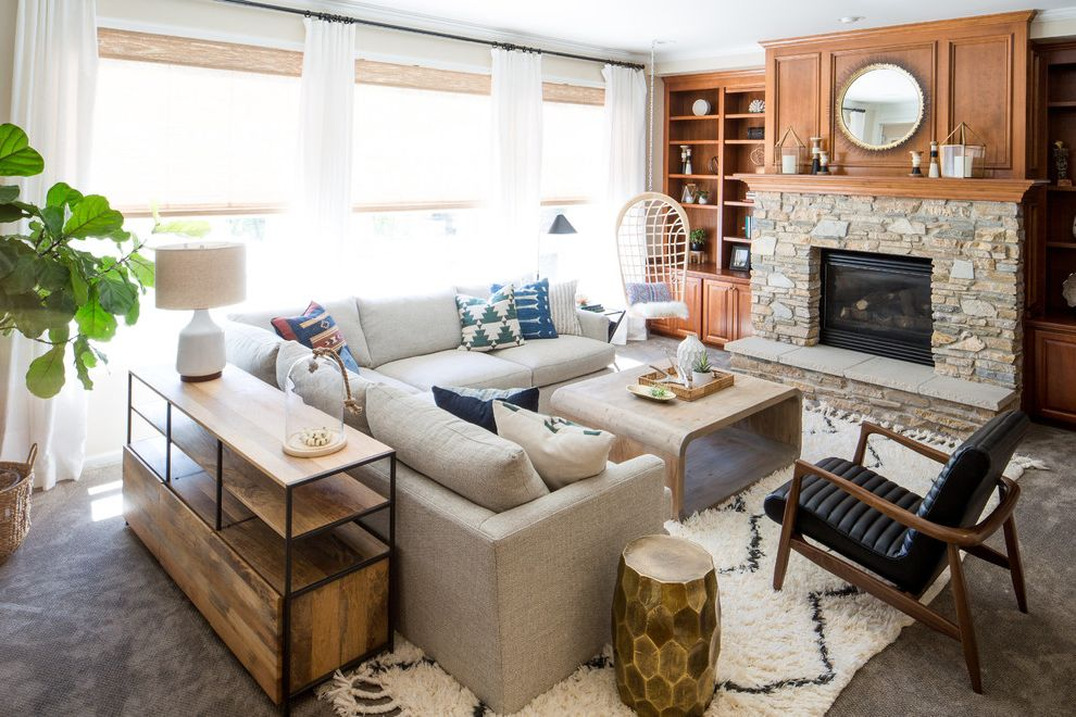 Crate and Barrel Chicago   Beach Style Living Room Also Beige Lamp Shade Black and Wood Armchair Black Armchair Gray Carpet Gray Sectional Hanging Chairs Indoor Plant Round Mirror White Curtains White Table Lamp