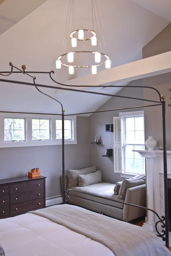Crate and Barrel Chicago   Traditional Bedroom  and Baseboards Canopy Bed Chandelier Day Bed Double Hung Windows Dresser Floating Shelves Grey Walls Neutral Colors Sloped Ceiling Vaulted Ceiling White Wood Window Shutters Wood Molding