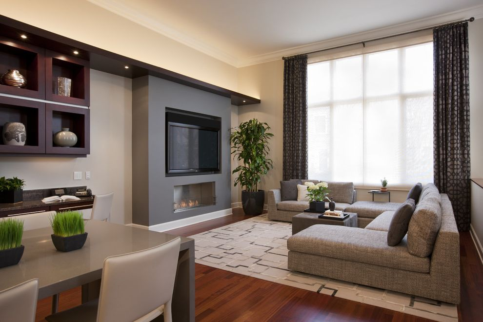 Crate and Barrel Chicago with Contemporary Family Room Also Area Rug Corner Sofa Crown Molding Curtains Drapes Great Room House Plants Open Floor Plan Sectional Sofa Tv Above Fireplace Wall Shelves White Wood Window Sheers Window Treatments Wood Trim