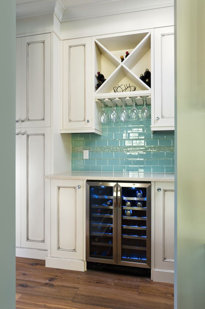 Culinair Wine Cooler with Traditional Kitchen  and Bar Blue Glass Tile Backsplash Built in White Cabinets Glass Rack Hardwood Floor Home Bar Wet Bar Wine Fridge Wine Storage X Pattern