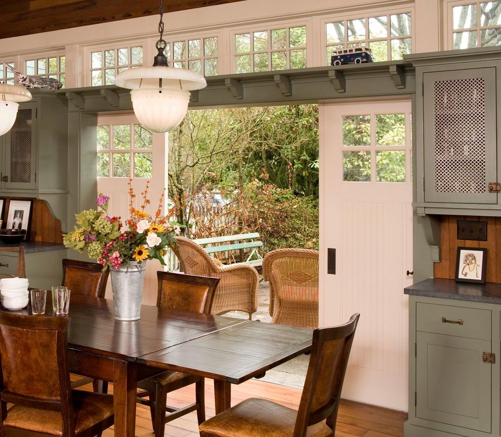 Dania Seattle with Farmhouse Dining Room  and Barn Doors Ceiling Light Farmhouse Green Green Kitchen Cabinets Leather Armchair Patio Rustic Rustic Wood Table School House Light Shelf Wood Floor Wood Table Farmhouse Kitchen