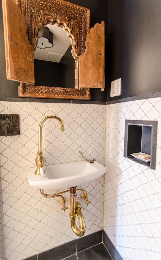 Delta Faucet Warranty   Mediterranean Powder Room Also Antique Carved Wooden Mirror Frame Arabesque Tile Dark Gray Walls Powder Room Sink Slate Soap Dish Niche Unlacquered Brass Gooseneck Faucet
