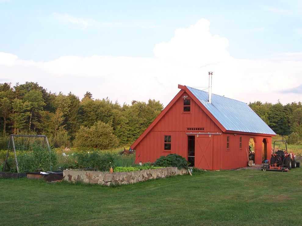 Down to Earth Lawn Care with Traditional Shed Also Barn Door Barn Hinge Board and Batten Forest Garden Garden Wall Kitchen Garden Gable Roof Metal Roof Planting Bed Raised Bed Red Barn Rock Wall Saltbox Roof Sliding Door Stone Tractor Yard