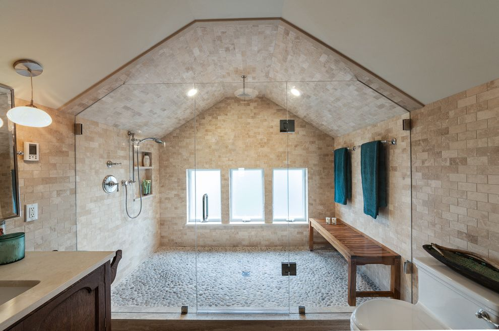 Electricians Lincoln Ne   Transitional Bathroom Also Beige Dual Shower Heads Frosted Glass Windows Globe Pendant Light Large Open Shower Large Shower Chamber Low Ceiling Pebble Tile Rainfall Shower Head River Rock Shower Floor Vaulted Ceiling
