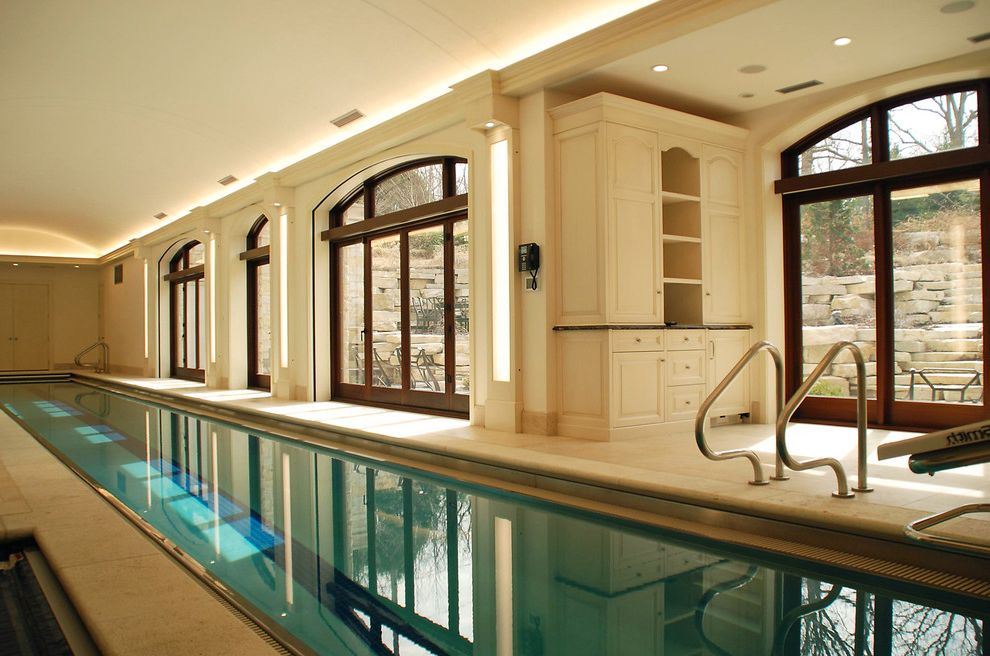 Endless Pools Cost   Traditional Pool Also Barrel Vault Chicago North Cove Lighting Custom White Cabinetry Design Build Highland Park Indoor Pool Lap Pool Large Arched Windows New Construction Vaulted Ceiling