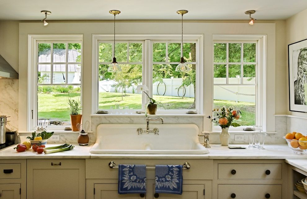 Farmhouse Sink Lowes with Traditional Kitchen  and Glass Pendants Marble Backsplash Marble Countertop Painted Cabinets Pendants Porcelain Sink Traditional Kitchen Yellow Cabinets
