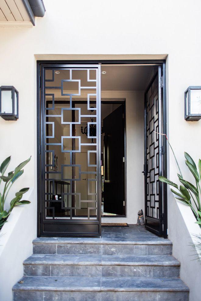 Foremost Homes   Contemporary Entry Also Black Door Black Powder Coated Screen Geometric Geometric Security Door Metal Door Modern Entry Modern Entry Door Sconces Screen Vestibule
