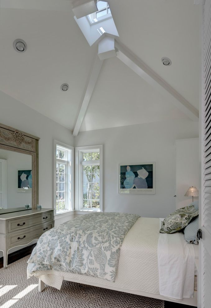 Fun Duvet Covers with Traditional Bedroom  and Area Rug Artwork Carved Wood Mirror Corner Window Cupola Dresser Lofted Ceilings Louvered Doors Sky Light Vaulted Ceiling White Painted Wood Beams White Walls