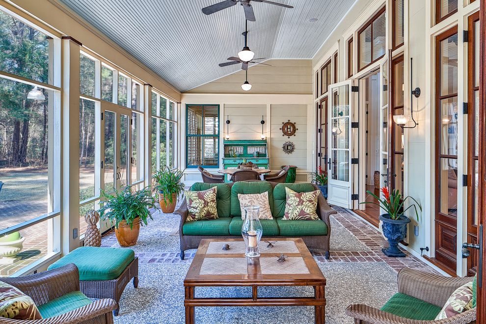 Furniture Stores Fort Myers   Traditional Sunroom Also Alfresco Dining Ceiling Fan Glass Doors Historical Concepts Jim Strickland Outdoor Furniture Potted Plants Screened in Porch South Carolina Spring Island Spring Island Real Estate Tom Jenkins