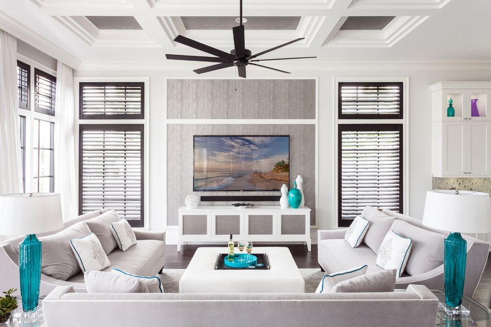 Furniture Stores Fort Myers   Transitional Family Room  and Ceiling Fan Coffered Ceiling Gray and White Gray Couch Louvered Shutters Wall Mounted Tv White Curtains White Ottoman