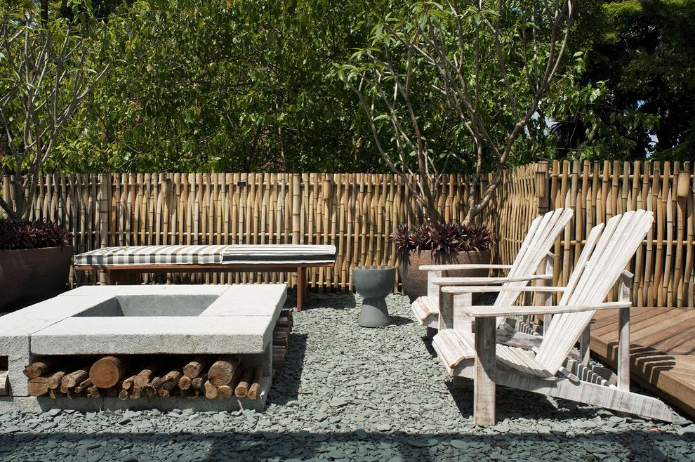 Furniture Stores Fort Myers with Tropical Patio Also Adirondack Chairs Bamboo Fence Container Plants Firewood Storage Outdoor Fire Pit Patio Furniture Permeable Paving Potted Plants Woven Fence