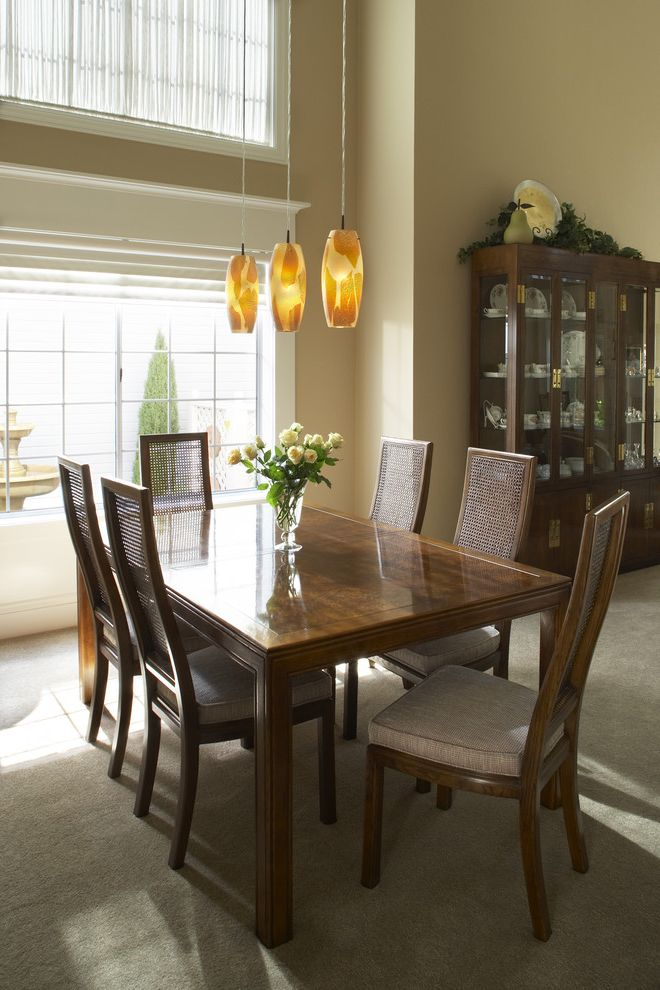 Furniture Stores in Baltimore with Traditional Dining Room  and Beige Wall Cane Chair Dining Buffet Dining Hutch Floral Arrangement Pendant Lighting Wood Dining Table