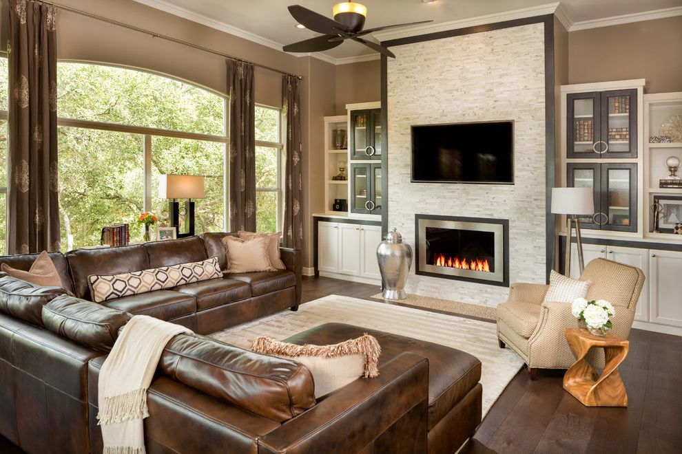 Furniture Stores in Knoxville Tn   Transitional Family Room  and Arched Window Beige Area Rug Beige Armchair Brown Sectional Sofa Built in Cabinets Ceiling Fan Silver Urn Wood Side Table