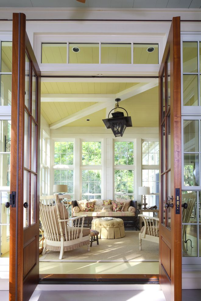 Furniture Stores in Savannah Ga with Beach Style Sunroom  and Area Rug Cottage Country Den Exposed Beams French Doors Lanterns Natural Rug Rustic Screen Porch Southern Sunroom Traditional Vintage Wood Ceiling Yellow Floor