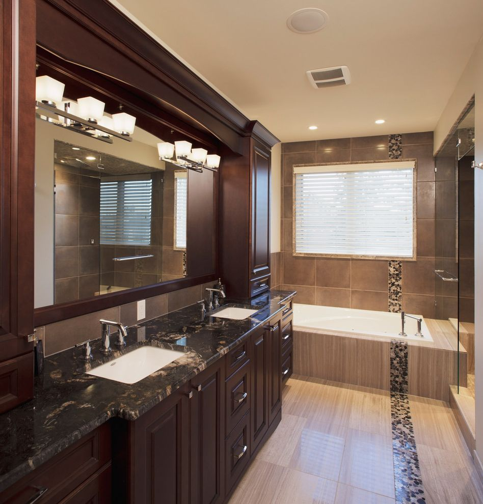 Granite City Omaha   Traditional Bathroom  and Blinds Custom Woodwork Dark Stained Wood Double Sinks Marble Counter Mirror Soaking Tub Tile Floor Wall Sconce