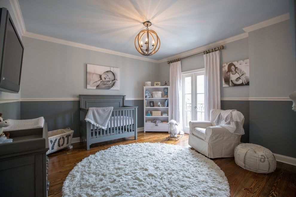 Gray Baby Cribs with Transitional Nursery Also Changing Table Enclosed Chandelier Gender Neutral Nursery Gray Crib Gray Nursery White and Gray Nursery White Armchair White Curtains White Round Rug Wood Floors
