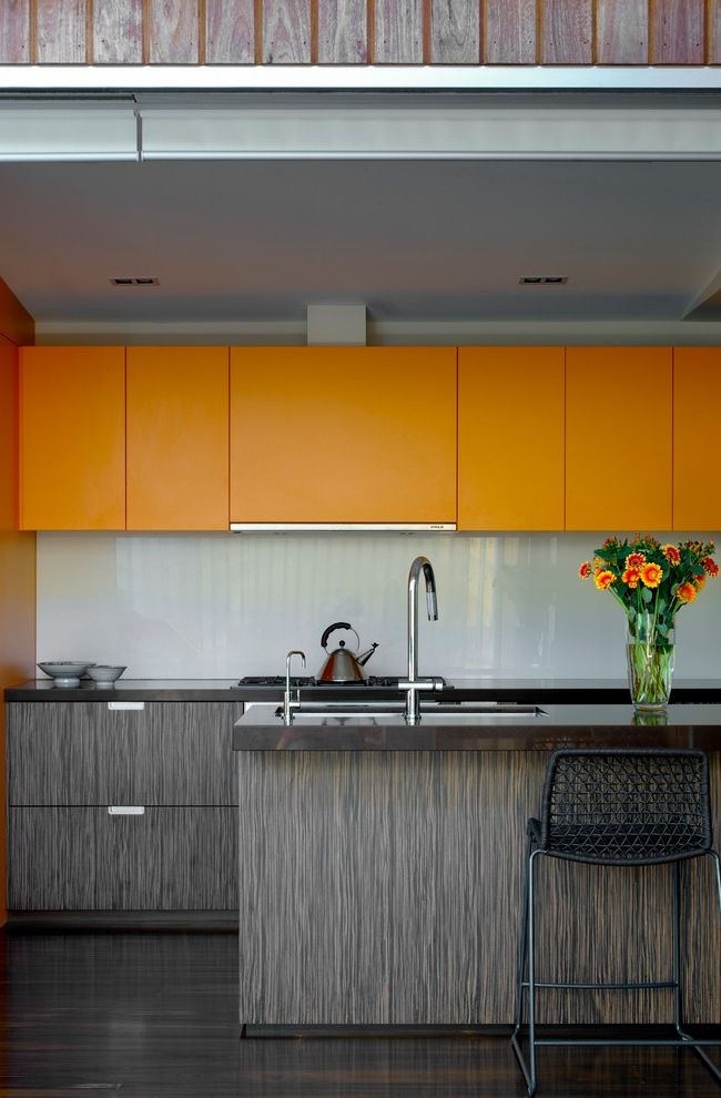 Hafele Usa with Modern Kitchen Also Counter Stools Dark Stained Wood Floor Glass Backsplash Kitchen Island Orange Upper Cabinets Recessed Lights Wood Cabinets Wood Grain Wood Paneling Wood Slats