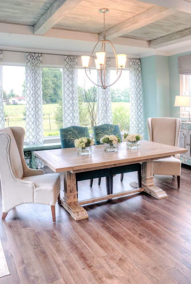 Heating and Cooling Louisville Ky   Transitional Dining Room  and Beams Chandelier Curtains Dining Tables Flower Arrangement Hardwood Floors Light Blue Wall Neutral Colors Table Lamp Vases Whitewashed Windows Wing Chair Wood Paneling