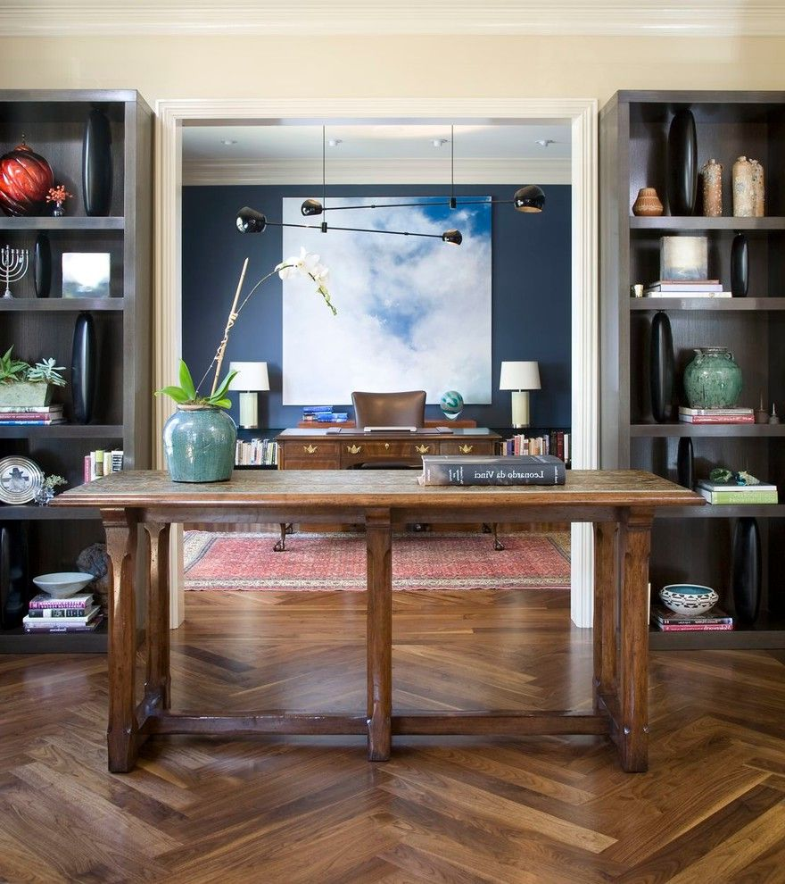 Herringbone Wood Floor with Eclectic Home Office  and Cloud Art Cream Walls Crown Molding Gray Book Shelves Herringbone Wood Floor Navy Blue Walls Oriental Rug Red Persian Rug Suspension Lights Wood Desk Wood Entry Table