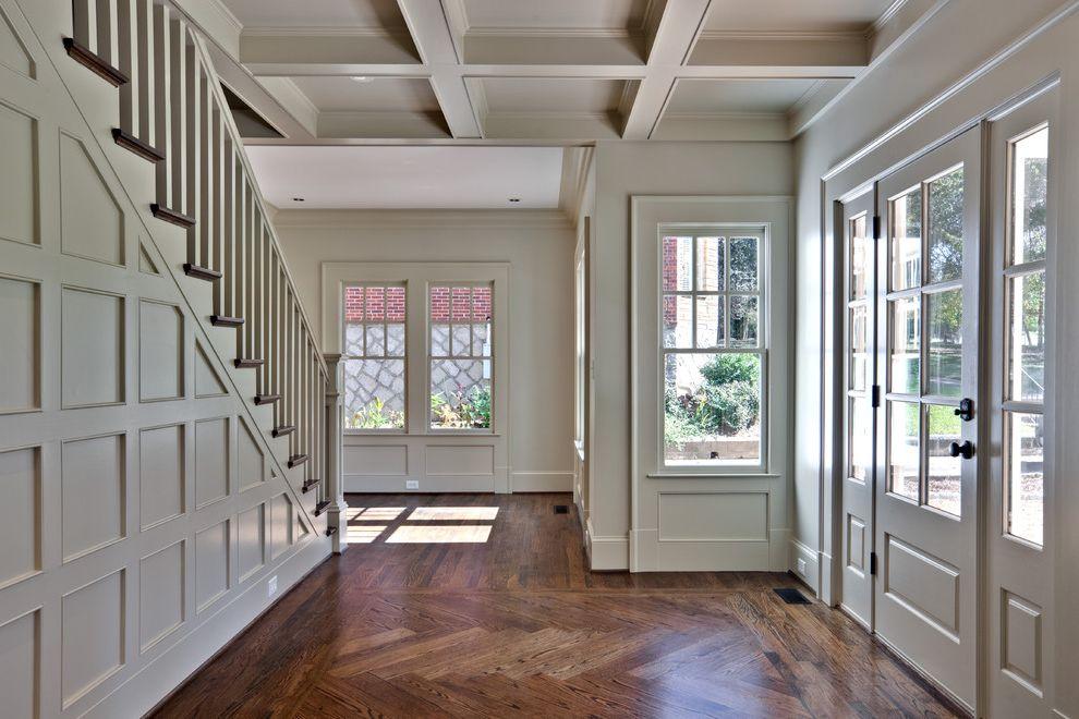 Herringbone Wood Floor with Traditional Entry Also Coffered Ceiling Front Door Herringbone Wood Flooring Wood Paneling Wood Trim Wooden Staircase