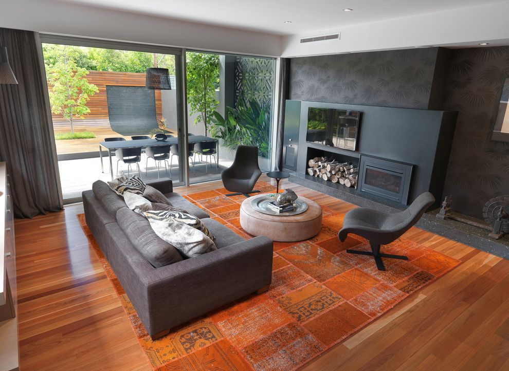 Home Goods Area Rugs   Contemporary Family Room  and Drapes Fireplace Glass Door Glass Wall Gray Sofa Gray Wallpaper Modern Pedestal Chair Modern Sofa Orange Rug Patchwork Rug Patio Plasma Tv Round Ottoman Tom Vac Chairs