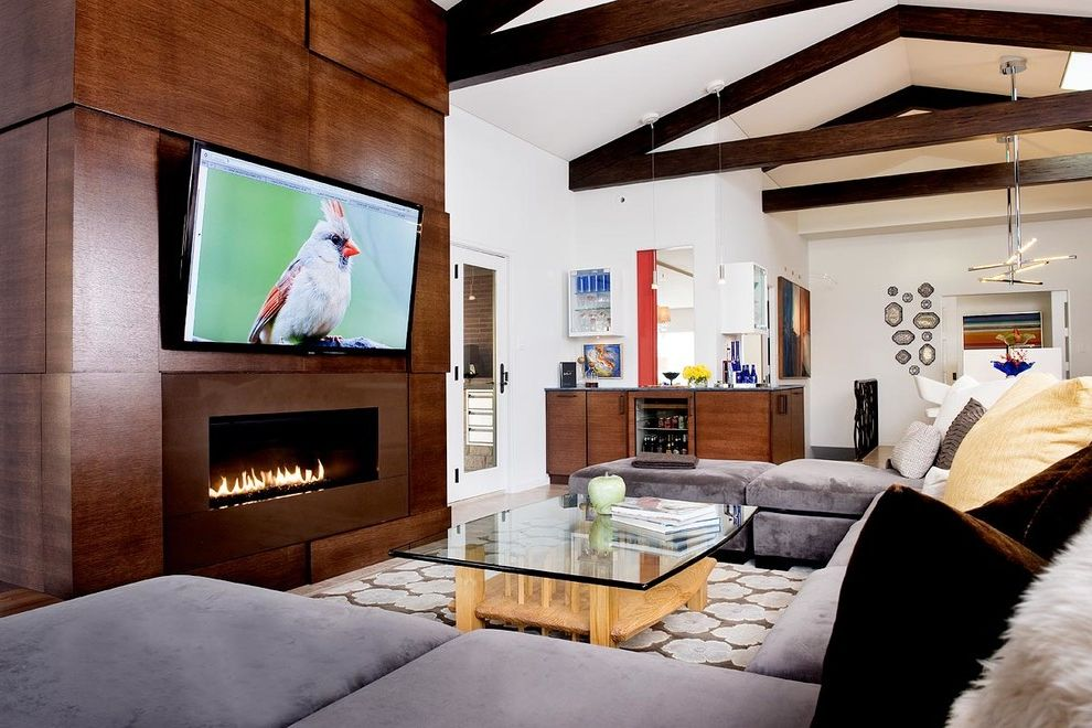Homemade Tv Mount   Modern Family Room  and Area Rug Fireplace with Tv Glass Coffee Table Linear Modern Fireplace Modern Fireplace Open Kitchen Sloped Ceiling Tv Above Fireplace Vaulted Ceiling Wall Mount Tv Wood Paneling Wood Trusses