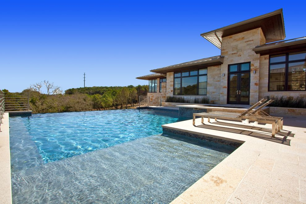 House of Tans   Contemporary Pool Also French Doors Infinity Edge Lounge Chairs Metal Railing Patio Pool Stone