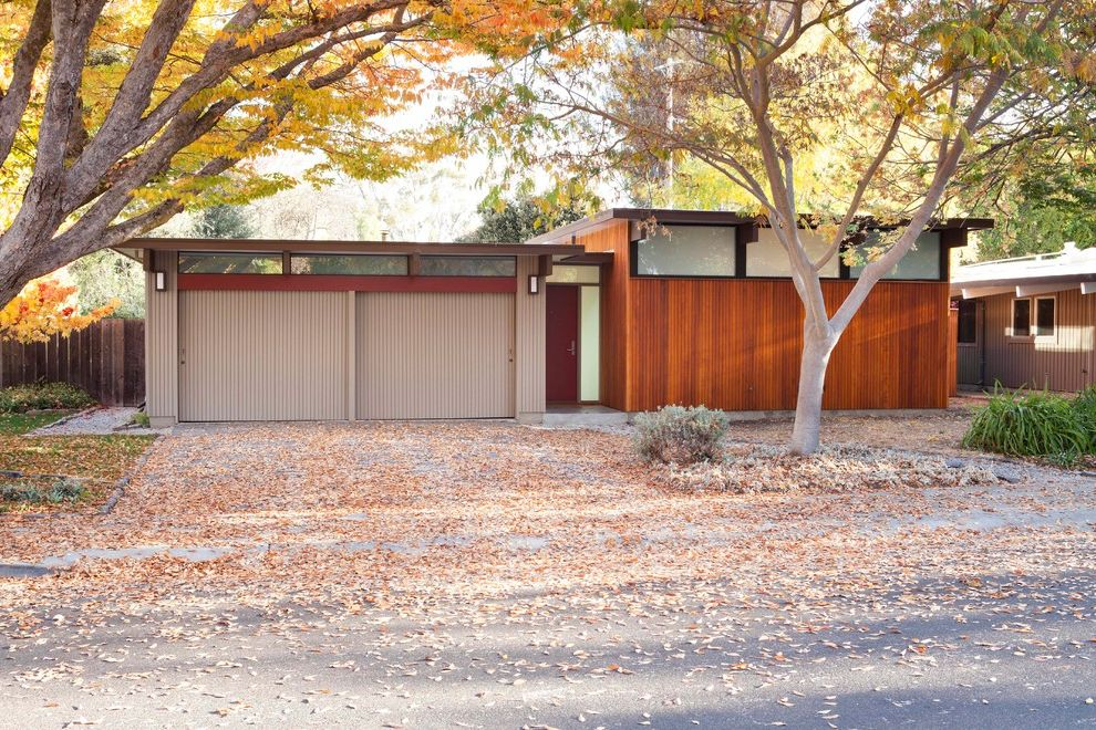 House of Tans   Midcentury Exterior Also Autumn Leaves Front Door Maroon Door Midcentury Style House Modern House One Story Single Story House Tan Garage Door Two Car Driveway Two Car Garage Wood Cladding Wood Siding