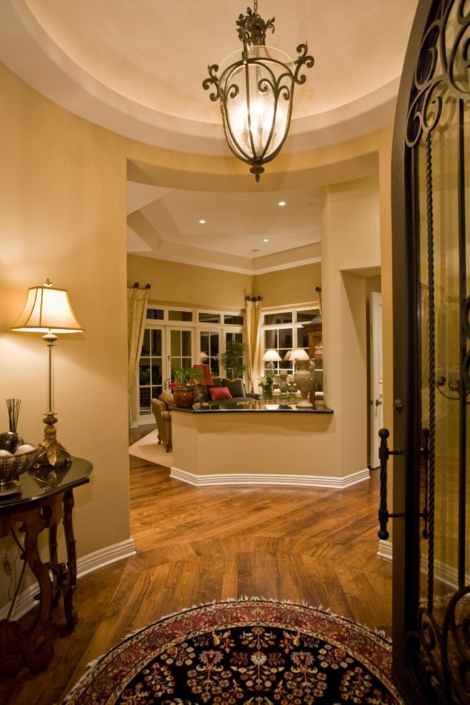 House of Tans   Traditional Entry Also Beige Hallway Crown Molding Dark Wood Side Table Entry Floral Rug French Windows High Ceiling Wood Flooring