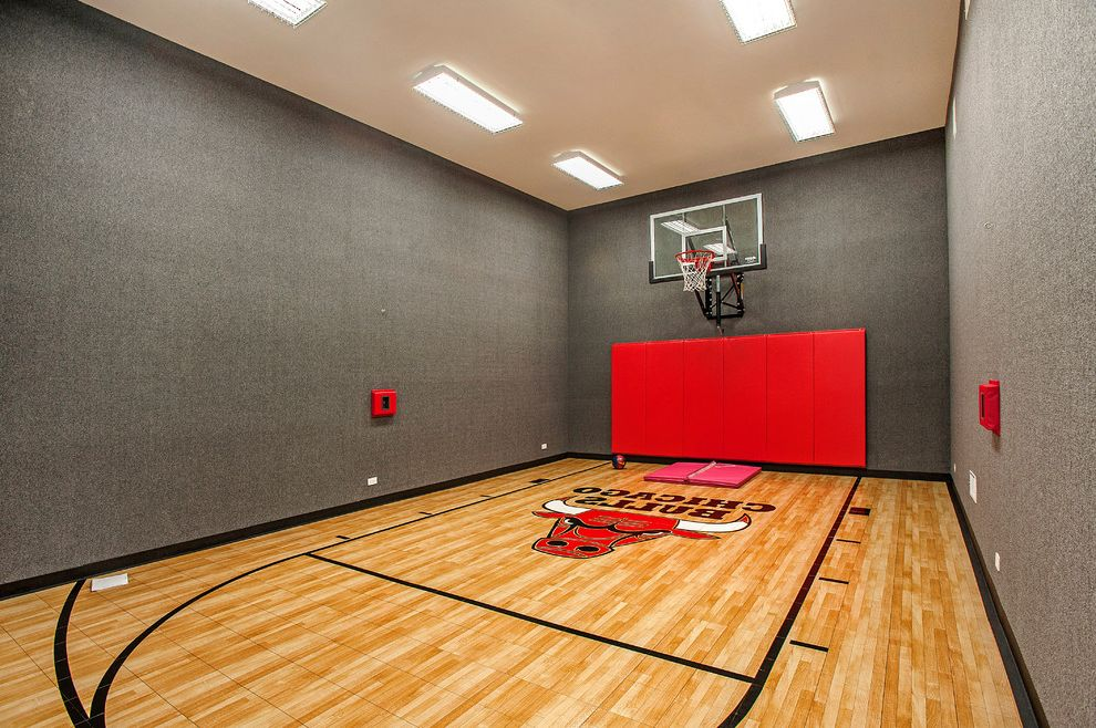 How Much Does a Basketball Court Cost   Contemporary Home Gym  and Basketball Court Carpet Walls Ceiling Lights Chicago Bulls Gray Walls Indoor Basketball Court Large Basketball Court Red Mats Vaulted Ceiling