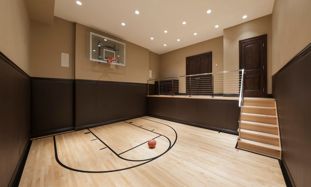 How Much Does a Basketball Court Cost with Contemporary Home Gym  and Baseboards Basketball Court Basketball Net Brown Walls Cable Railing Ceiling Lighting Half Court Maple Floors Recessed Lighting Specialty Room Tan Walls Wainscoting Wood Flooring